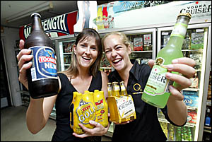 CELEBRATING the opening of the Biggabeen bottle shop ? just in time for Christmas ? were Donna Morrison and Sarah Long.