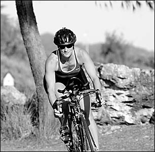Marg Hill shows her form during the bike leg of Sunday?s teams? triathlon. Photo:BRUCETHOMAS 05122929A