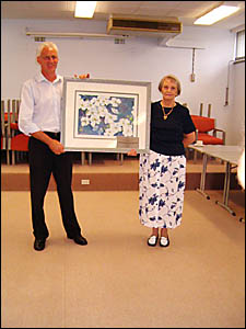 CULTURAL DONATION: Artsfest president Fay Boyd presents the painting to hospital executive officer John Wickham.