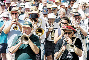BLOWING THEIR TRUMPETS: Participants in the Jazz Convention on the march in Molesworth Street, Lismore, yesterday.