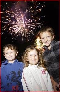 Ryan Warren, Brianna Phillips and Joel Phillips of Caloundra enjoy the fireworks at Charlton Speedway.