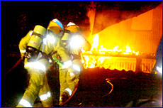 Firefighters battle the flames at a house fire at Yarwun on Monday