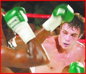 Toowoomba boxer Mick Katsidis trades blows with Fred Kinuthia at the Broncos Leagues Club.