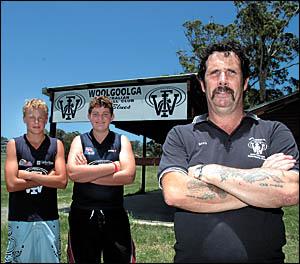 Clouded future . . . Woolgoolga AFL diehard Dave Dodsworth with young Woolgoolga AFL players Shannon Burol and Justin Dodsworth