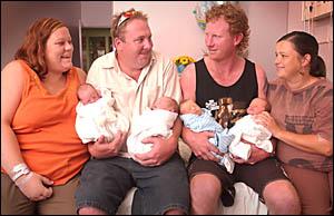 Ainsley Good and Al Kilduff, holding the couple?s twin girls Mia Eliza and Ella Kylie, with Al Kilduff, holding twins Caleb and