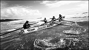 The Urunga reserve surf boat crew head through the wash in the NSW Country Surf Life Saving championships at Woolgoolga on Satu