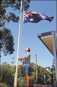 A patriot act . . . Dallas Burrage raises the flag outside his Sawtell home.