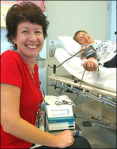 Australian Red Cross Blood Service nurse Sandra Huxley goes through the process of taking blood from Vonda Connell.