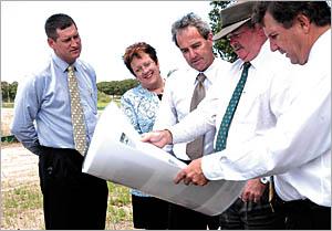 Chief radiation therapist Stuart Greenham, Coffs Harbour Health Campus manager Margaret Bennett, project manager Kevin Plummer,