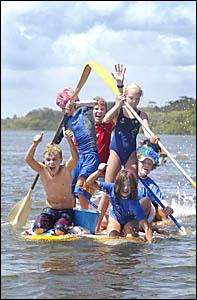 CABARITA Beach SLSC Nippers roar towards the raft race finish line: Jordan Charters, Brett Clark, Brodie Charters, Nathan Bride