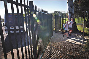 Zoo-style fence is schools?  answer to vandals