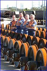 Callemondah wagon repair depot crew (from left) Russell Pershouse, Peter Wagenknecht, John Radnedge and Greg Popp at work.