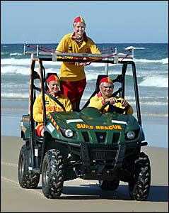 CHERIE Raso, Annie Lingwood and Gary Raso in the Salt Surf Life Saving Club?s patrol vehicle.