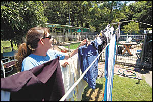 Living next door to the Coffs Creek flying fox colony means Leoni Hutchinson has to take in the washing before the fruit bats s