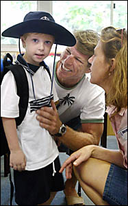 STARTING school were Dainton Hickey, 5, with his parents Martin and Gail Hickey.