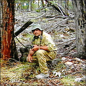 Yowie expert Paul Compton with one of six grass beds he claims belong to the elusive yowie. He said the beds were always built