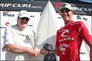 ON A ROLL: Michael Peterson with winner of the Rip Curl MP Classic Dave Reardon-Smith, along with his trophy and replica MP boa