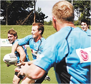 It?s a shark attack . . . Cronulla players Brett Kimmorley and Beau Scott train with their team-mates at the International Stad