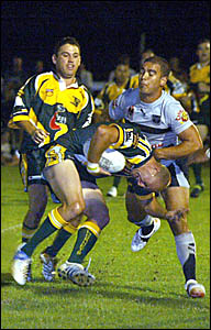 Cudgen?s Troy Hilder ducks into a tackle as teammate Craig Thurston watches on during the Friday night?s trial match against th