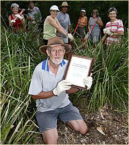 BUSH CARE: Tom Fletcher shows off the Australia Day Award for Environmental Achievement awarded to the Elanora Wetlands Bushcar