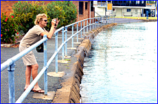 Gloria Chapman takes a snap at the Goondoon Street boat ramp as Gladstone had one of its highest tides.