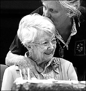Kerry Smith gives her long-time friend, Margaret Howes, a kiss at her 100th Birthday celebration.