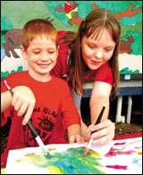 Boyne Island State School?s Keely Magdalinski, 11, and Lewis Adams, 5, get started on designs for a new logo.