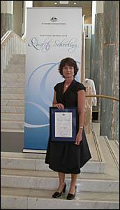 Lynette Eggins with her award.