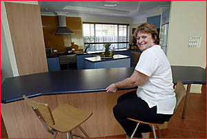 LARAINE Whyte from L.J Hooker Pottsville in the luxury kitchen of the Elfan Avenue property.