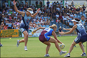 South Queensland Sharks player Emma Giarola is surrounded by South Queensland Sharks players Amanda Judd, left and Maribel Ziab