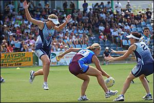 South Queensland Sharks player Emma Giarola is surrounded by South Queensland Sharks players Amanda Judd, left and Maribel Ziab