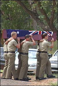 Mourners and pall bearers at the funeral of Nathan Gilbert in Grafton yesterday.