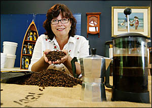 Robyn Cousins with some Caldera Coffee beans which won three bronze medals at the Sydney Easter Show.