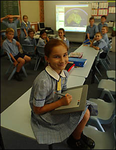 YEAR 4 student Kirra Petty, 9, shows new electronic black- boards at the Clarence Valley Anglican School work.