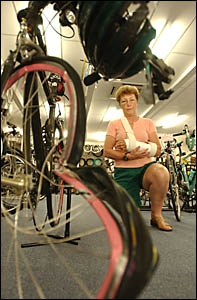 Di Roberts with her damaged bike and body after a freak accident with a kangaroo.