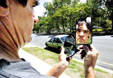 Kevin Simmons is disgusted that the side mirrors were smashed from his car.has Rockhampton police on high alert.