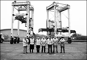Isoloader?s business development manager Eric Ronco (second from left), and commissioning engi- neer Matt J