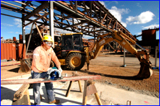 Marcus Dennien prepares for the next stage of construction on Comalco's research and development centre.