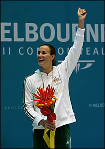 Tweed swimmer Sophie Edington acknowledges the crowd after winning gold at the Commonwealth Games.