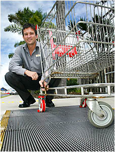 TWEED City Shopping Centre manager Michael Tree with a mesh device installed to help prevent trolleys leaving the centre car