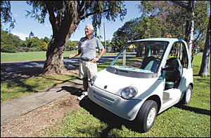 Doug Winn with the ultra-modern electric golf buggy he has been refused provisional registration for. He says the increasing nu