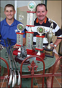 Graham Dewberry, right, and son Ryan with the trophies they picked up at from the Grafton Golf Club championships.