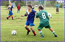 Tamara Hofstetter and Tori Van Vegchel compete in an early round of the Sportspower Girls Soccer Challenge.