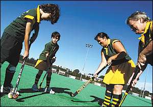 Preparing for the start of the 2006 hockey competition, from left, Nicholas Johnstone, Sean Lovering, Rebecca Johnstone and Bar
