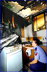 Firefighter Kristal Johnston inspects the damage.