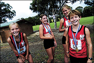 Sawtell Toormina Little Athletics Centre medal winners, from left, Emma Robson, Nicole Gusman, Cassie Maddocks and Jarvis Dunca