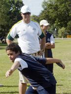 Discus thrower Benn Harradine gives year 8 student Jarrod Lucas some tips yester-
