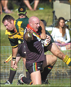 Orara Valley second rower Dave Simons wrestles Sawtell Panthers captain-coach Craig Wallace to the ground during the opening ro