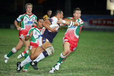 Central Comets centre Odell Manuel terrorises the Wynnum Manly defence.