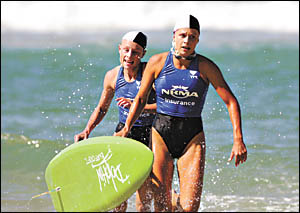 Sawtell sisters Bonnie and Courtney Hancock on the beach at Kurrawa where the two combined to win a gold medal in the under-19